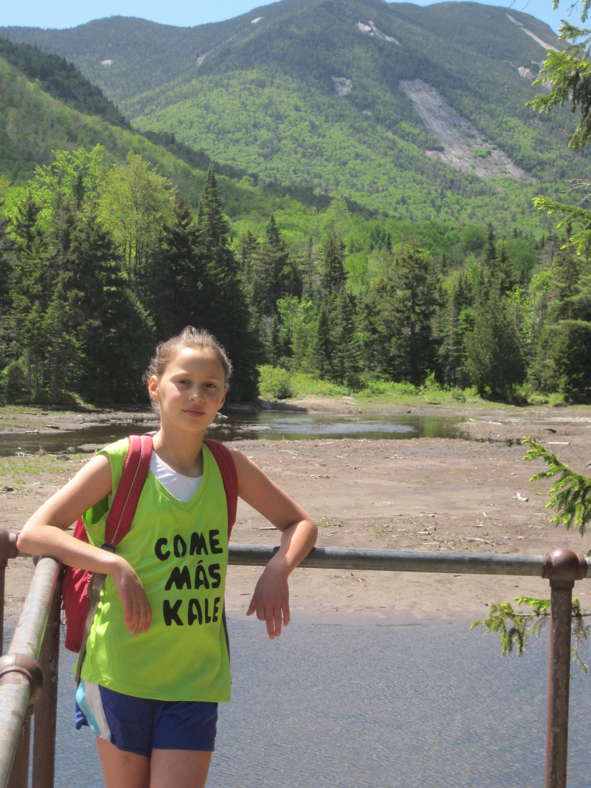 Evalin-hikes-to-Phelps-Mtn.-photo-at-Marcy-Dam-June-2014